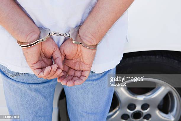 USA, Illinois, Metamora, midsection of man with handcuffs on hands