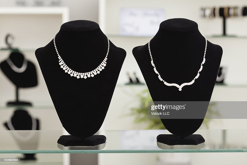 USA, Illinois, Metamora, necklaces on display in jewelry store