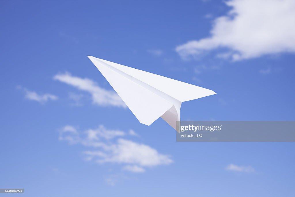 USA, Illinois, Metamora, Paper airplane flying against sky