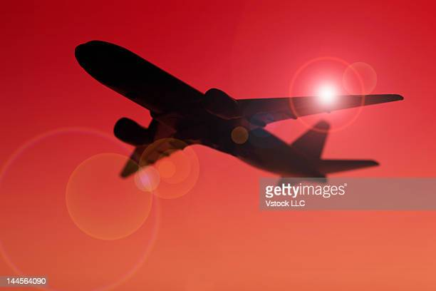 USA, Illinois, Metamora, Silhouette of airplane against red sky