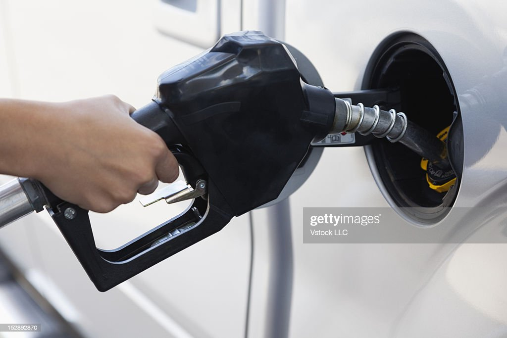USA, Illinois, Metamora, woman holding fuel pump