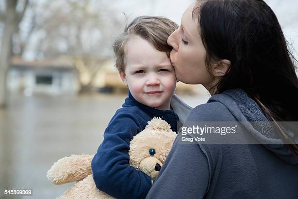 USA, Illinois, Mother with son standing in flooded town