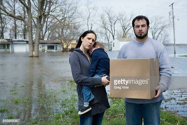 USA, Illinois, Parents with son standing in flooded town