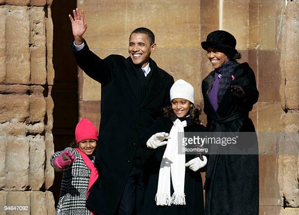 Illinois senator Barack Obama waves to the crowd with his wife Michelle and two daughters Sasha left and Malia Ann after announcing his candidacy for...