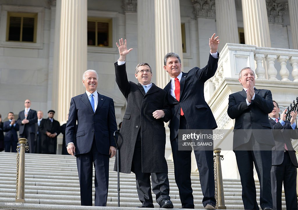 Illinois Senator Mark Kirk (C) waves as he is welcomed by US Vice President Joe Biden (L) and his colleagues upon his return to the Senate on January 3, 2013 after suffering a stroke last January. Krik was welcomed by his colleagues on the step of the Senate a year after a stroke affected the right side of his brain. Kirk spent a year relearning how to walk in intensive physical therapy. The 113th Congress convenes Thursday fresh from the year-end fiscal cliff fiasco, but lawmakers will ring in 2013 casting a wary eye towards the even tougher budget battles that lie ahead. AFP PHOTO/Jewel Samad