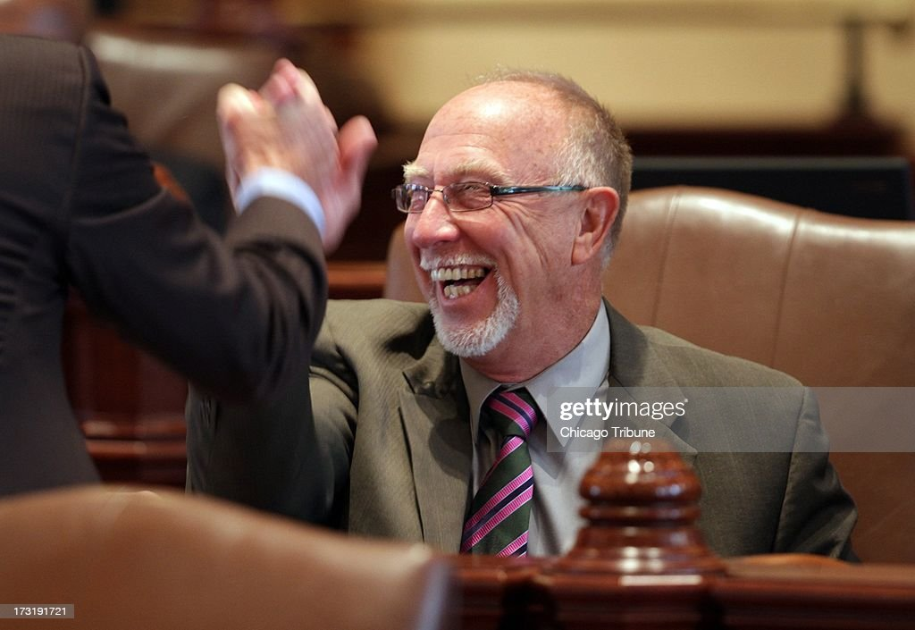 Illinois state Sen. Gary Forby is congratulated by lawmakers Tuesday, July 9, 2013, after Gov. Pat Quinn's veto of concealed carry legislation was overridden by lawmakers in Springfield, Illinois.