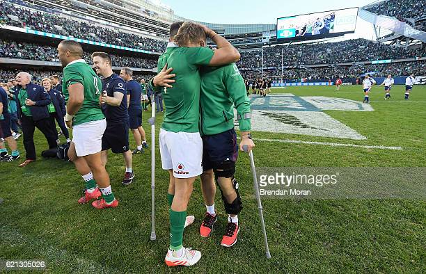 Illinois United States 5 November 2016 Conor Murray of Ireland with injured teammate Jordi Murphy after the International rugby match between Ireland...