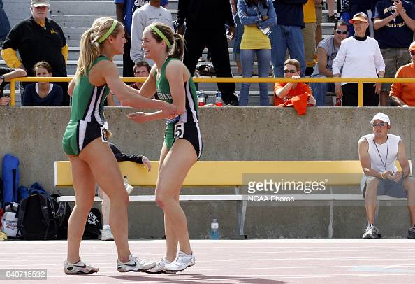 Illinois Wesleyan senior Rachel Anderson wins the 200 meter dash finals with a time of 2476 and greets teammate Ali McCoy a sophomore who finished...