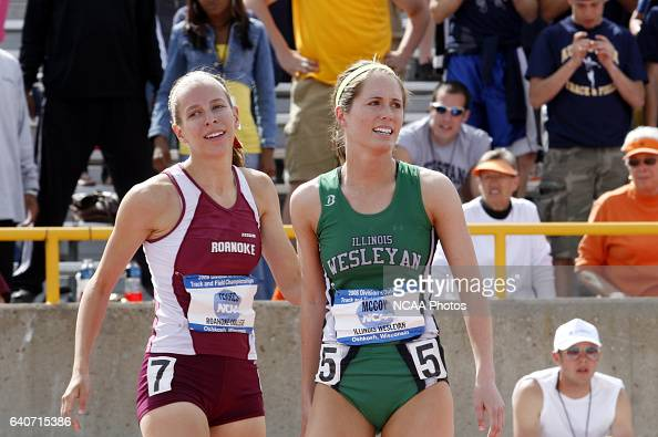 Illinois Wesleyan sophomore Ali McCoy and Roanoke sophomore Robin Yerkes cool down after the finish of the 200 meter dash finals during the Women's...