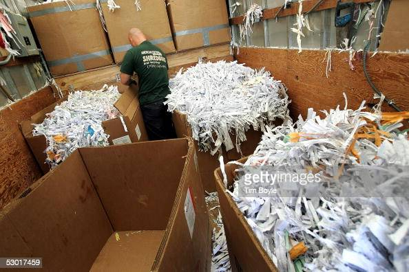 Illinoisbased American Mobile Shredding and Recycling worker Ken Greifelt arranges boxes of shredded documents in the company's mobile document...
