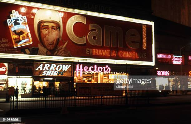 Illuminated advertising for 'Camel' cigarettes in Los Angeles around 1958