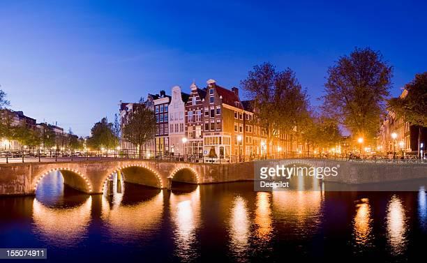 Illuminated Amsterdam Canal Bridges at Night Holland
