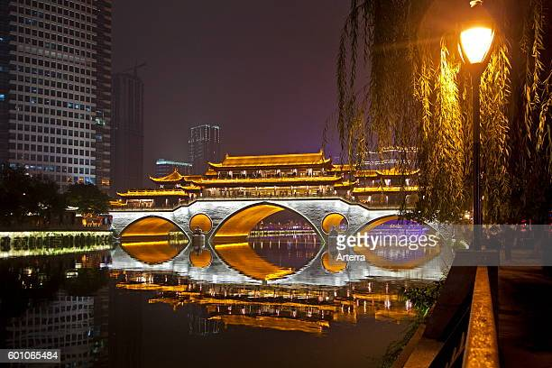 Illuminated Anshun Bridge over the Jin River at night in the provincial capital of Chengdu in Sichuan China