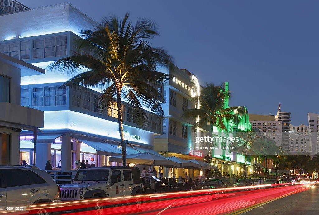 illuminated art deco buildings in ocean drive stock photo. Black Bedroom Furniture Sets. Home Design Ideas