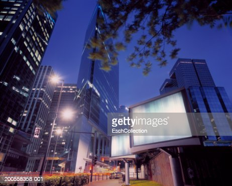 illuminated billboards in a modern business district, low angle view : ストックフォト