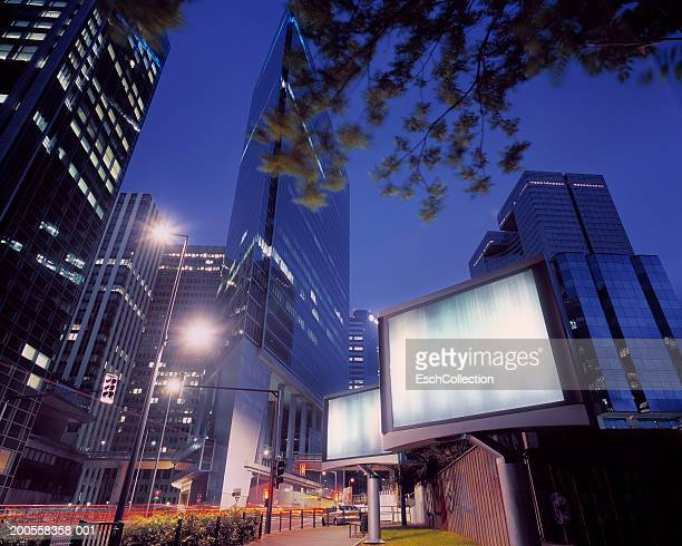 illuminated billboards in a modern business district, low angle view