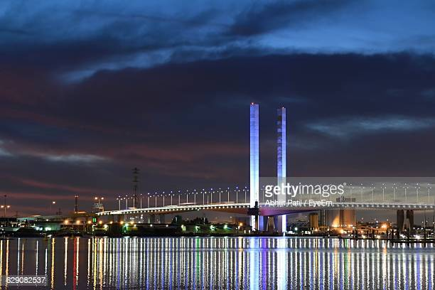 Illuminated Bolte Bridge Reflection In Yarra River Against Sky
