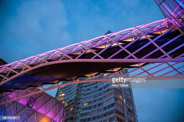 Illuminated bridge with purple light in Paris