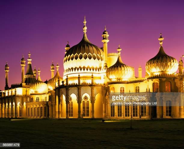 Illuminated Brighton Pavilion building at dusk, Brighton, Sussex, United Kingdom