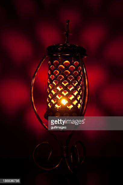 Illuminated bronze metallic lantern with lattice pattern
