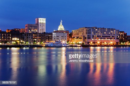 Illuminated buildings in Savannah city waterfront at night, Georgia, United States