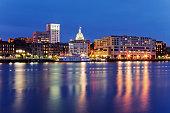 Illuminated buildings in Savannah city waterfront at night, Georgia, United States