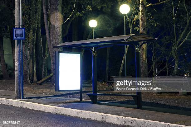 Illuminated Bus Stop At Night