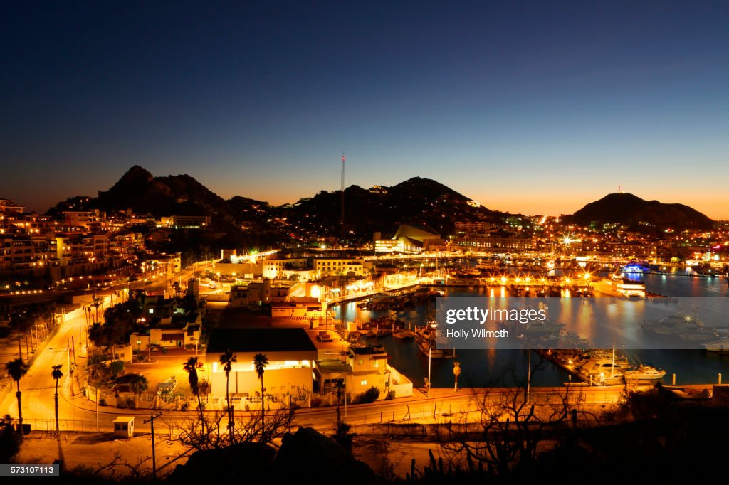 Illuminated Cabo San Lucas cityscape at sunset, Los Cabos, Mexico