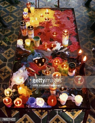 Illuminated candles on table, elevated view : Stock Photo