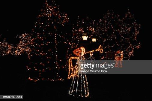 Illuminated christmas angels : Stock Photo