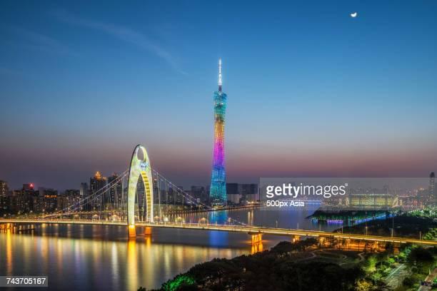 Illuminated city and bridge at night, Guangzhou, Guangdong, China