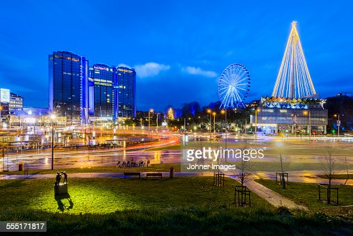 Illuminated cityscape with Ferris wheel