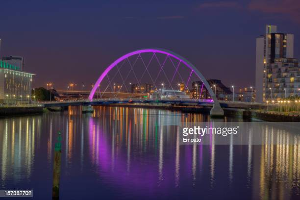 Illuminated Clyde Arc / Squinty Bridge, Glasgow, Scotland at night.