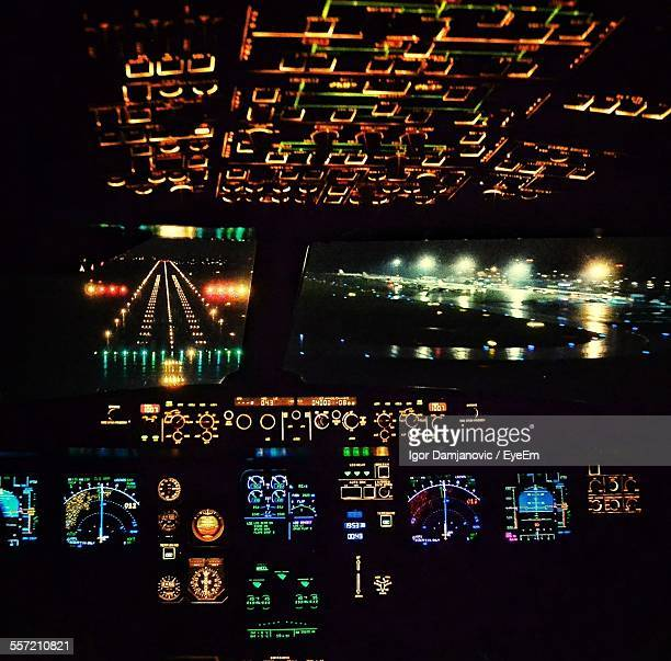 Illuminated Cockpit At Night