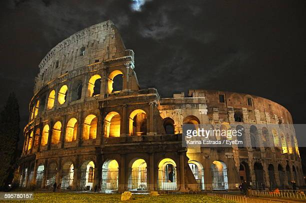 Illuminated Coliseum Against Sky At Night