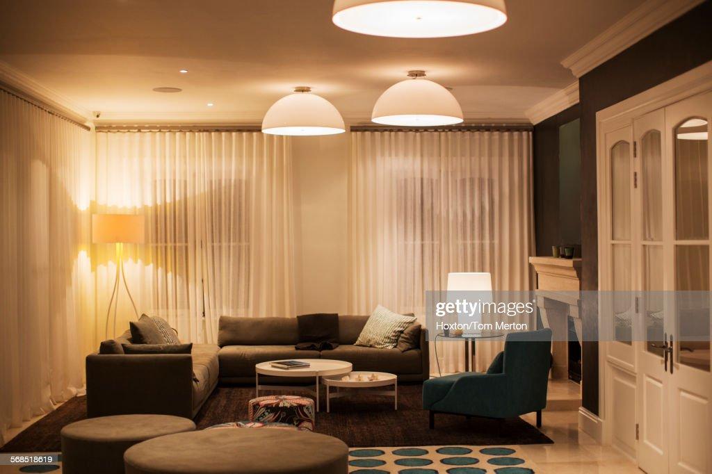 Illuminated Domed Lights Over Home Showcase Living Room : Stock Photo