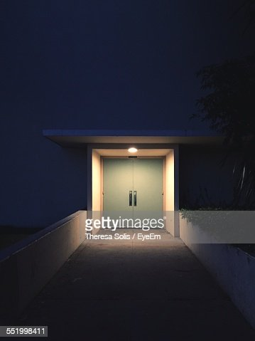 Illuminated Doorway At Night