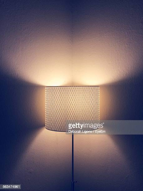 Illuminated Electric Lamp Against Wall