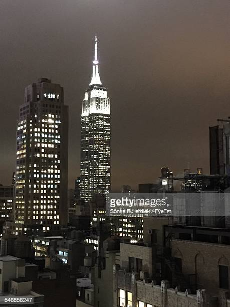 Illuminated Empire State Building Against Sky At Night
