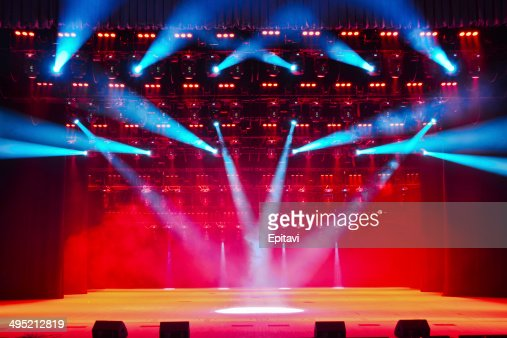 Illuminated empty theater stage with smoke : Stock Photo