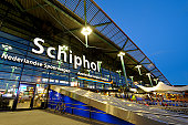 Illuminated entrance of Amsterdam Airport Schiphol at night