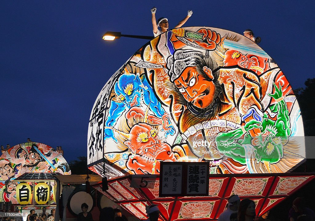 Illuminated floats 'Neputa' march on during the Hirosaki Neputa Festival on August 1, 2013 in Hirosaki, Aomori, Japan. The festival, dating back in 1,722, will continue until August 7.