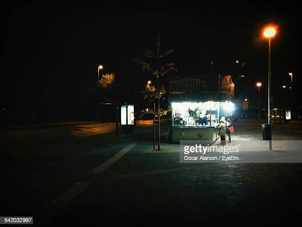 Illuminated Food Stall In City At Night