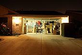 Illuminated garage with open door
