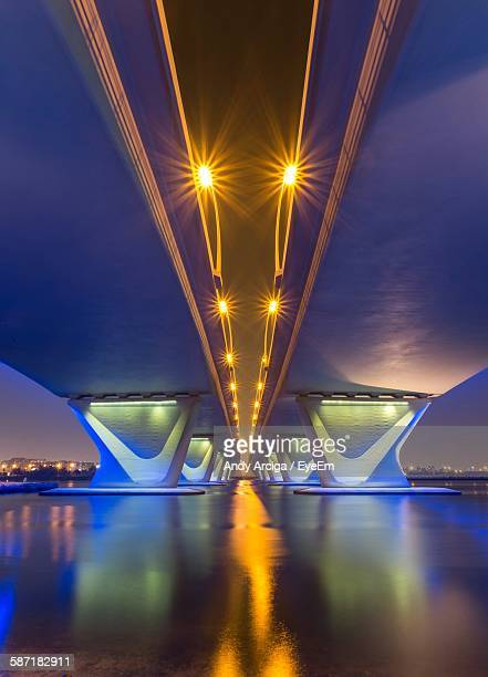 Illuminated Garhoud Bridge Over Dubai Creek During Dusk
