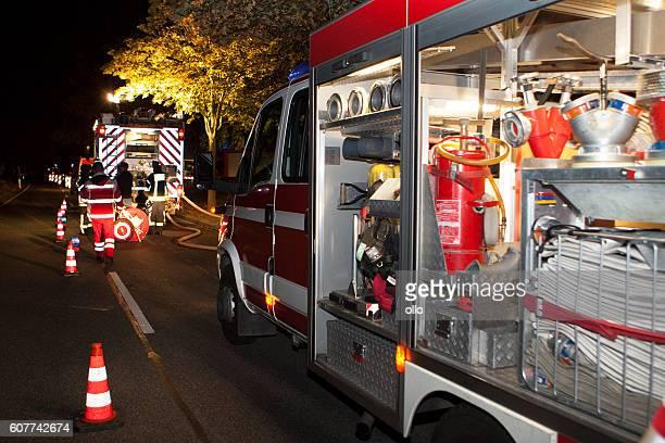 Illuminated German fire engine at incident scene