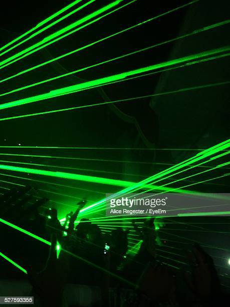 Illuminated Green Laser Lights At Nightclub