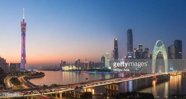 Illuminated Guangzhou TV Tower and Liede Bridge at dusk, Guangzhou, Guangdong, China