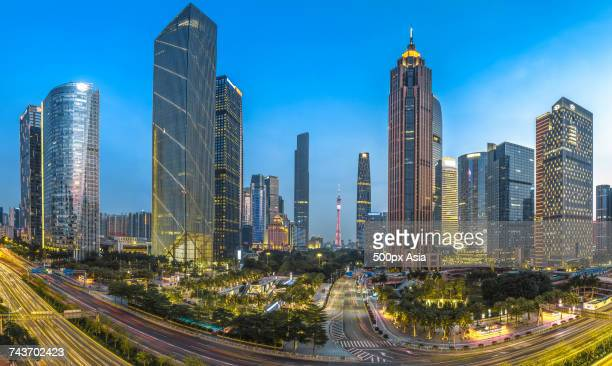 Illuminated Guangzhou TV Tower and other modern skyscrapers in financial district, Guangzhou, Guangdong, China