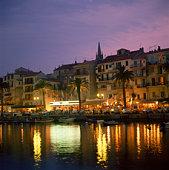 Illuminated harbor in Corsica
